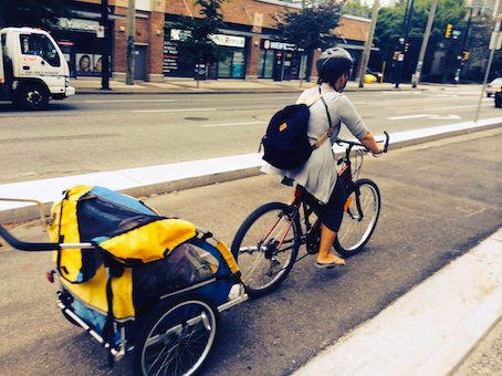 Mother and baby in sepated bike lane on Dunsmuir