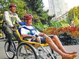 Mayor Gregor Robertson with Brian Hever, a resident of Yaletown House, trying out the care facility's new Duet Bike in Yaletown - Vancouver Cycling Culture