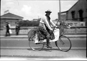 Here's a Vancouver cyclist from 1925, on a bike that was decorated to look like a horse - Vancouver Cycling Culture