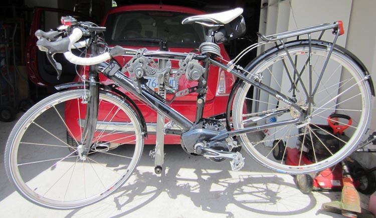 b962f24c2b9 My Panasonic electric race bike on a Thule Helium bike rack attached to a  Fiat 500