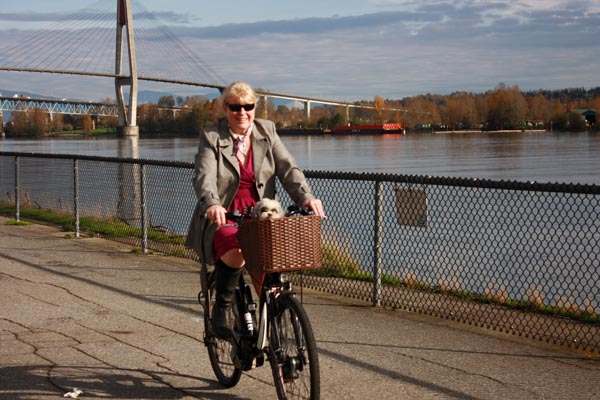 Maggie (Mrs. Average Joe Cyclist) finds sheer joy riding her electric bike - she doesn't have to drive or use transit, but she can still get around with a combination of muscle and electricity