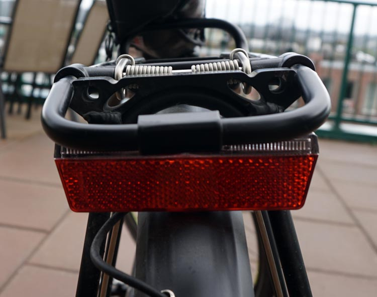 Haibike Xduro Trekking Pro Review. This is the integrated rear light of the Haibike Xduro Trekking Pro. It's stylish and easy, but could stand to be a little bigger. It is also a little bit compromised by the rack, as it is kind of squashed underneath it.